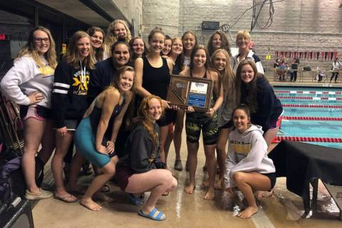 (Amy Wagner) Members of Boulder City High School's girls swim team celebrate winning the region ...