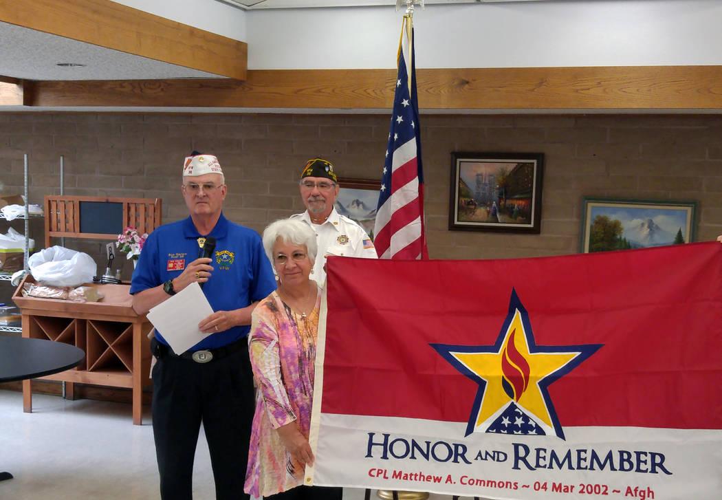 Pat Marek, center, stands with Past State Commander Robert Garlow, left, and Steve Andrascik of ...