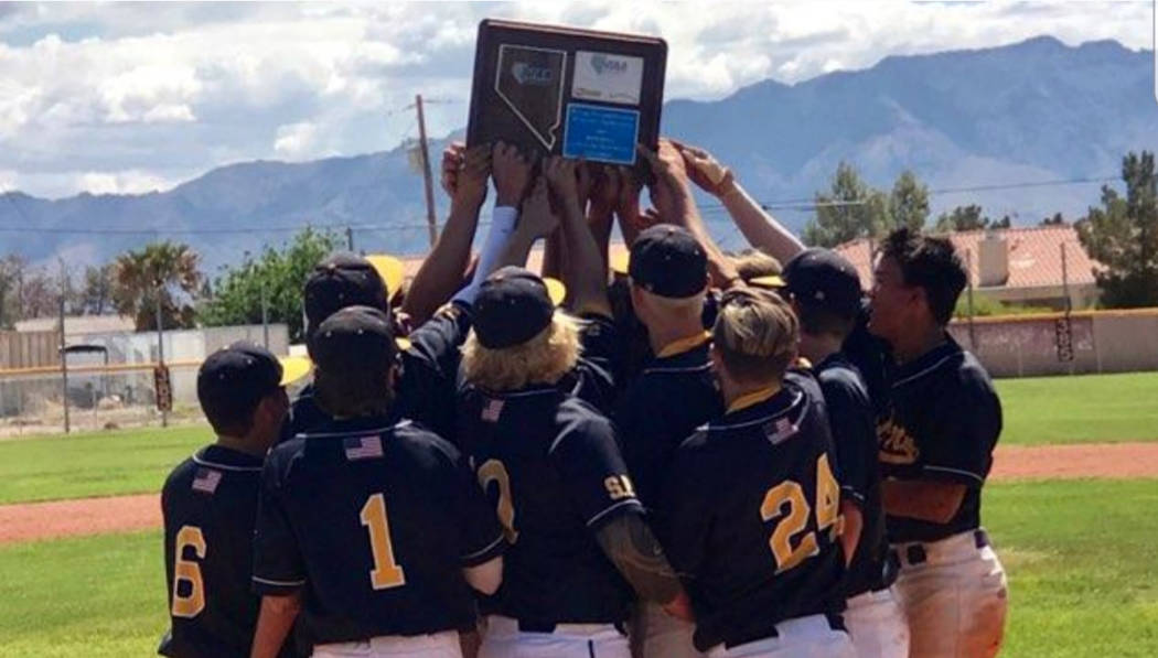 (Daphne Brownson) Members of Boulder City High School's baseball team celebrate winning the reg ...