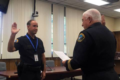 (Boulder City) Boulder City Police Chief Tim Shea, right, swears in new city marshal Michael Kr ...