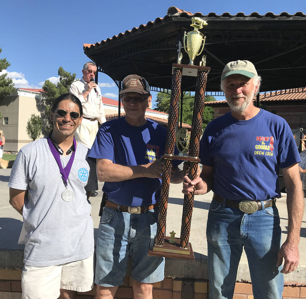 Larry Archuleta, left, president of the Rotary Club of Boulder City, congratulates Leon Drew, c ...