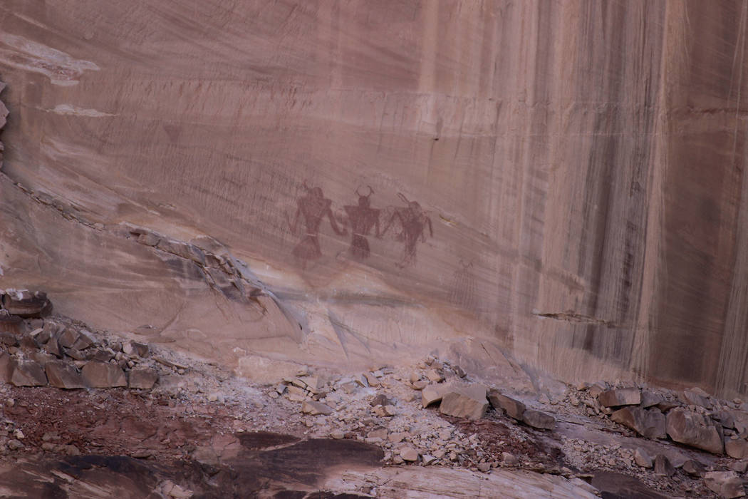 (Deborah Wall) These pictographs depicting warriors in a trapezoidal shape and head dresses are ...