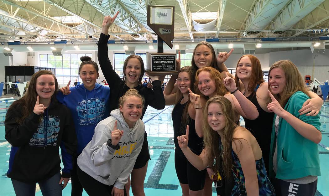 (Daphne Brownson) Members of Boulder City High School's girls swim team celebrae after winning ...