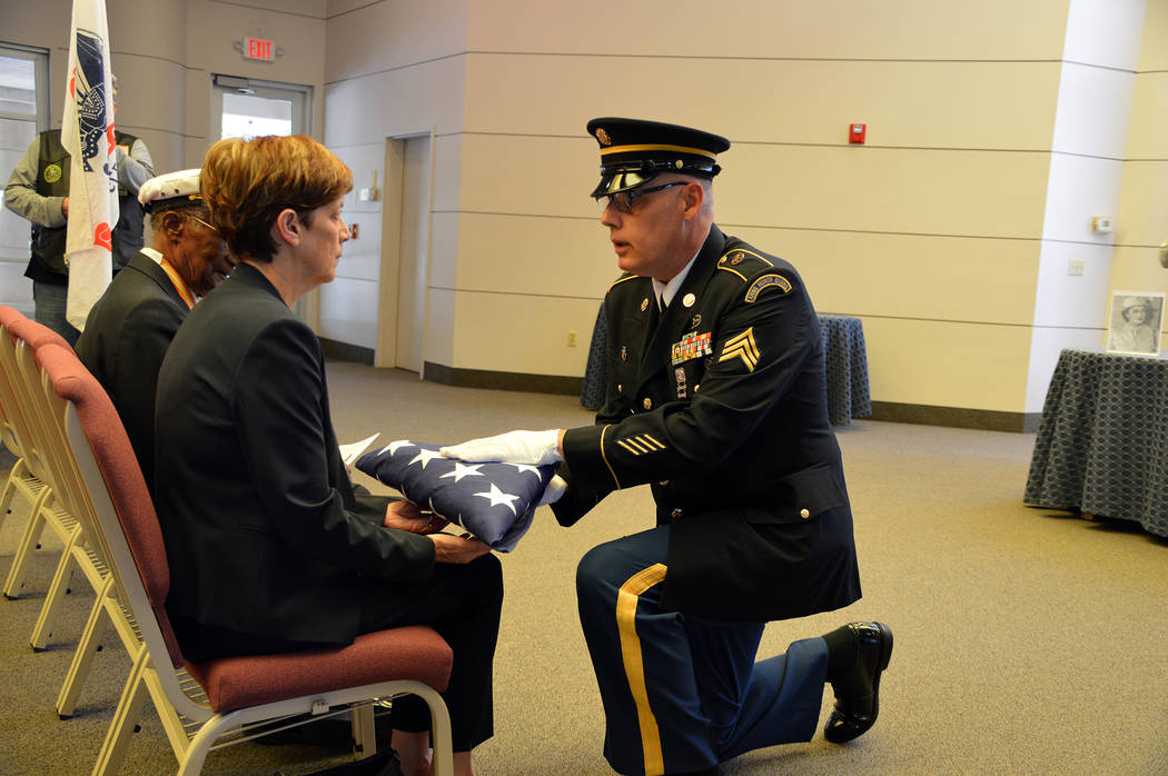 (Celia Shortt Goodyear/Boulder City Review) A U.S. Army sergeant presents an American flag to N ...