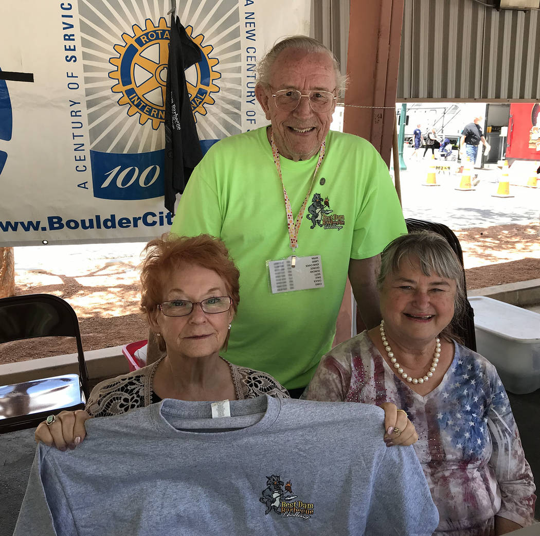(Hali Bernstein Saylor/Boulder City Review) Manning the information booth at the Best Dam Barbe ...
