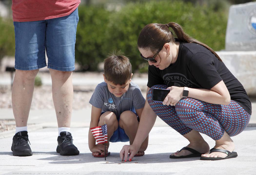 (Rachel Aston/Las Vegas Review-Journal) Sarah Vela helps her son Jace Vela, 5, place a pennies ...