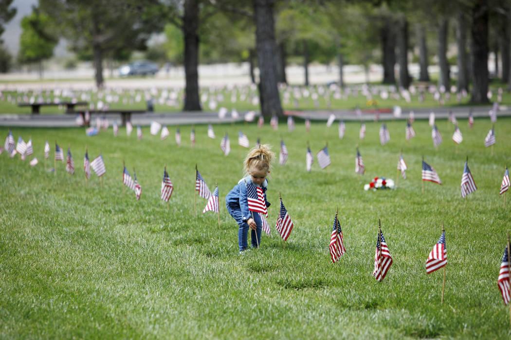 (Rachel Aston/Las Vegas Review-Journal) Liyah Makarechian, 3, places a flag at the Southern Nev ...