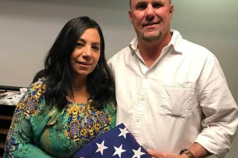 (Hali Bernstein Saylor/Boulder City Review) Mari and Joe Fex of Boulder City found a flag on th ...