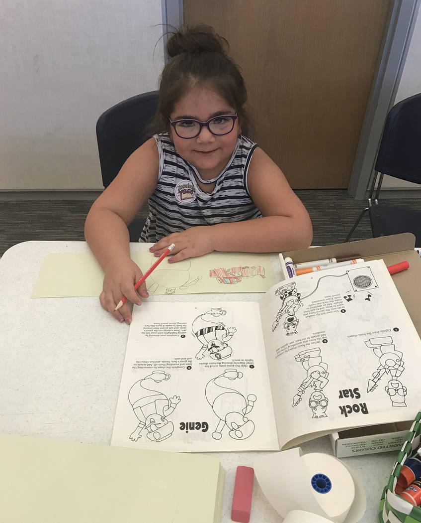 (Hali Bernstein Saylor/Boulder City Review) Leora Rose, 5, of Boulder City tries her hand at dr ...