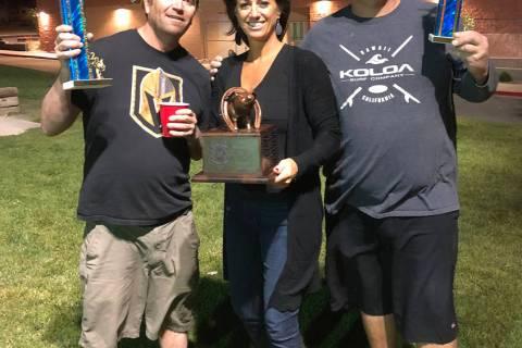 (Dan Leach Memorial Fund) Laura Leach, center, congratulates Roberto Andrade, left, and Tim Lyn ...