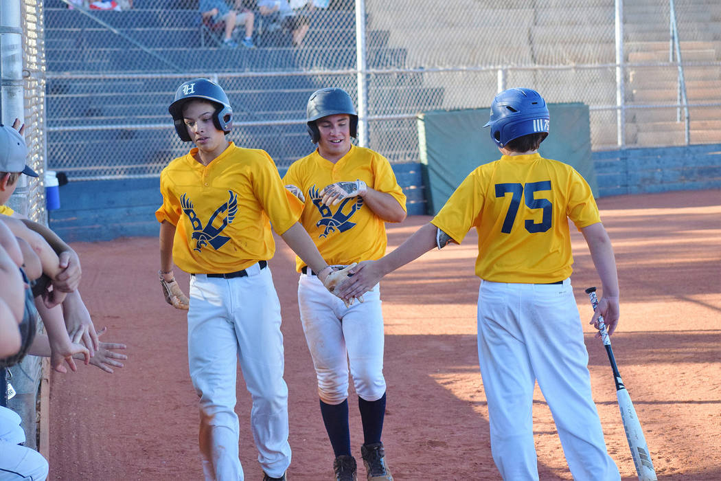 (Robert Vendettoli/Boulder City Review) After scoring a run Chase Calvez, left, followed by Isa ...