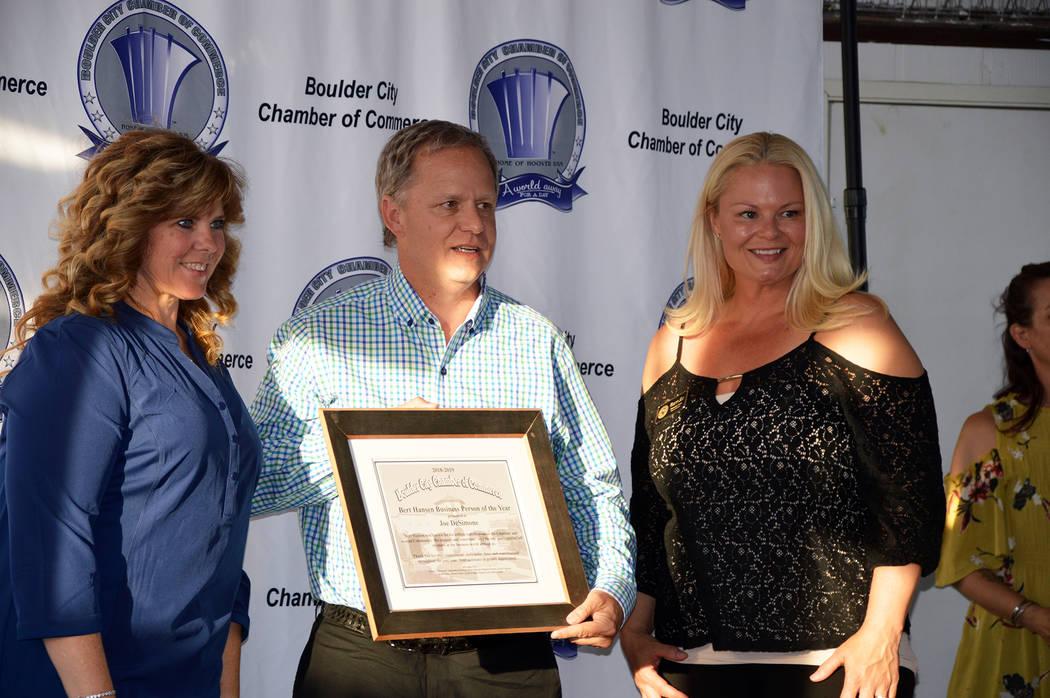 (Celia Shortt Goodyear/Boulder City Review) Joe DeSimone accepts the business person of the yea ...