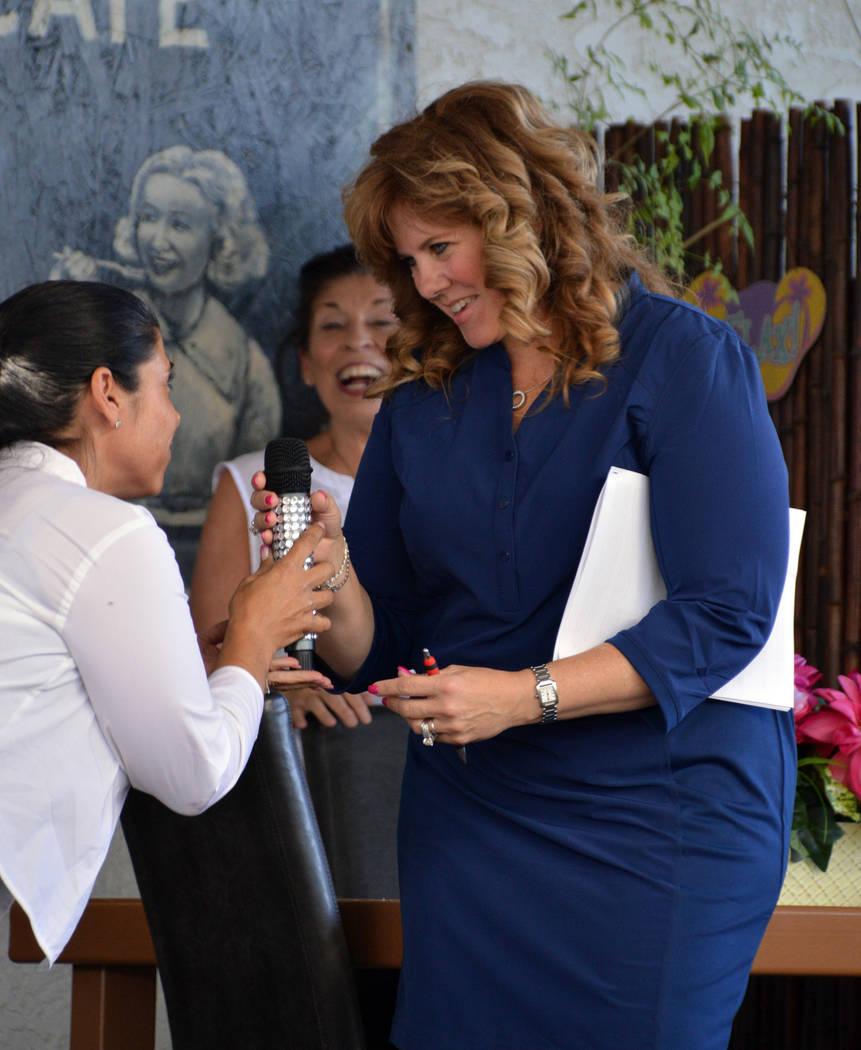 (Celia Shortt Goodyear/Boulder City Review) Jill Bunch, left, presents Boulder City Chamber of ...