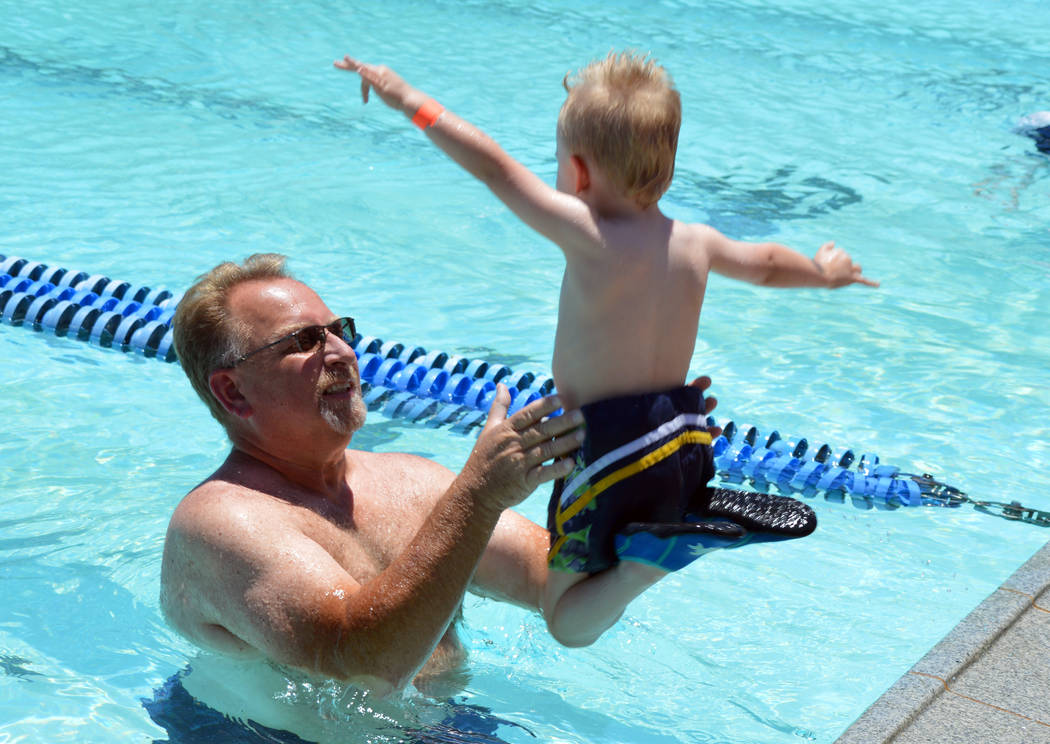 (Celia Shortt Goodyear/Boulder City Review) Odin Therien jumps into the arms of his grandfather ...