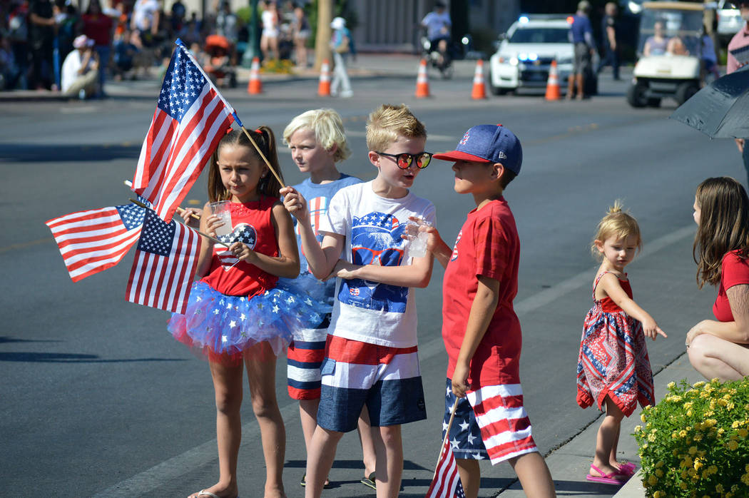 Some of the 70th annual Damboree parade's younger spectators talk in between the floats' arriva ...