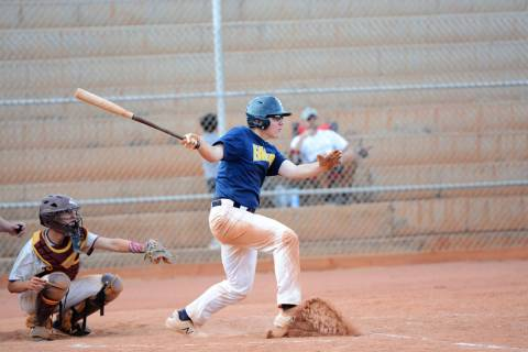 (Robert Vendettoli/Boulder City Review) Hitting a line drive to center field, Clark Newby drive ...