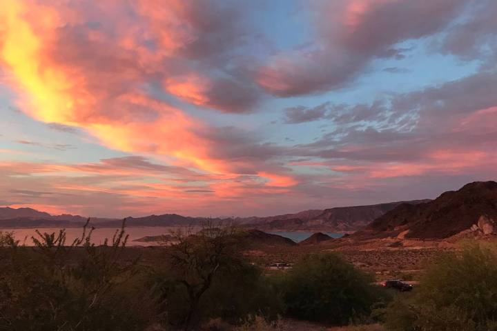 (Hali Bernstein Saylor/Boulder City Review) The sky above Lake Mead became a colorful palette S ...
