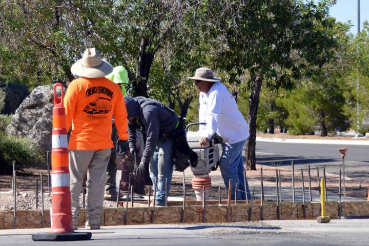 (Celia Shortt Goodyear/Boulder City Review) Workers begin the process of installing new crossin ...