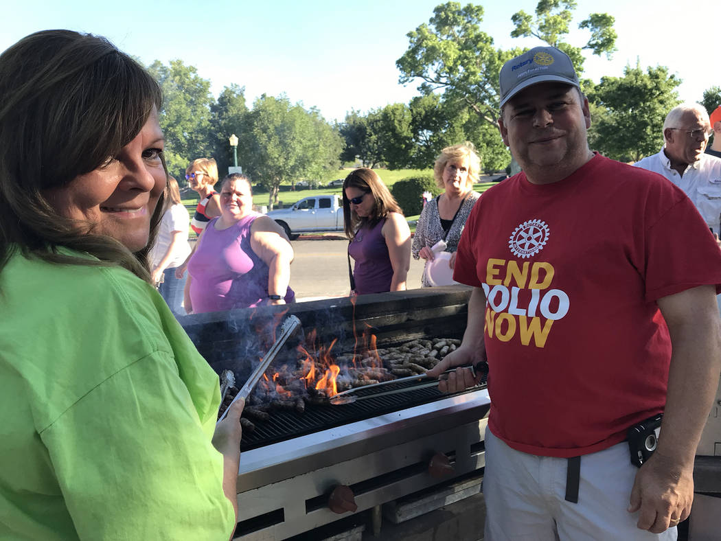 (Hali Bernstein Saylor/Boulder City Review) Rotarians Chris Romero, left, and John Chase cooked ...