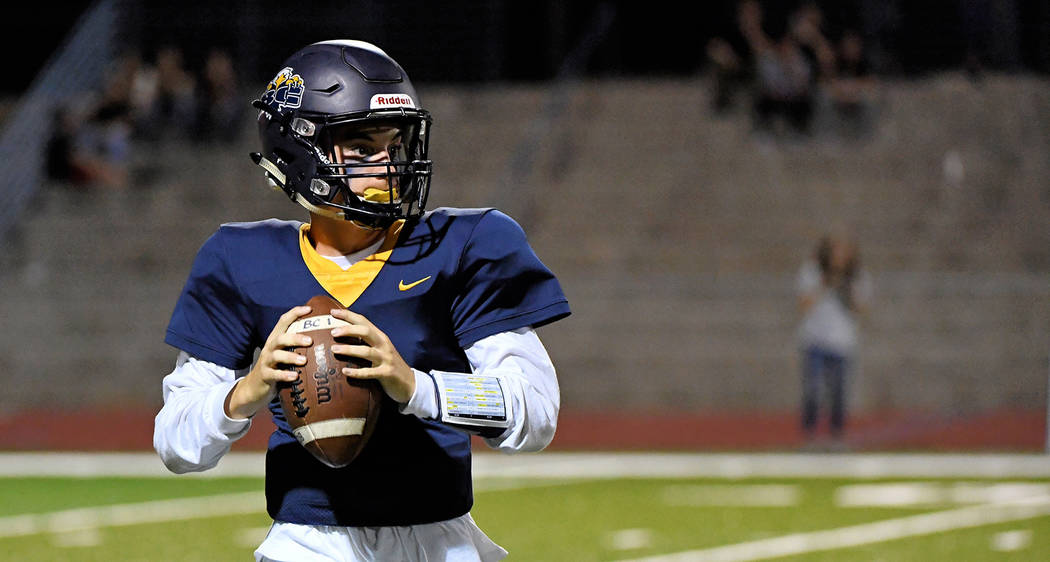 Boulder City High School is taking 50 football players from all levels of competition, includin ...