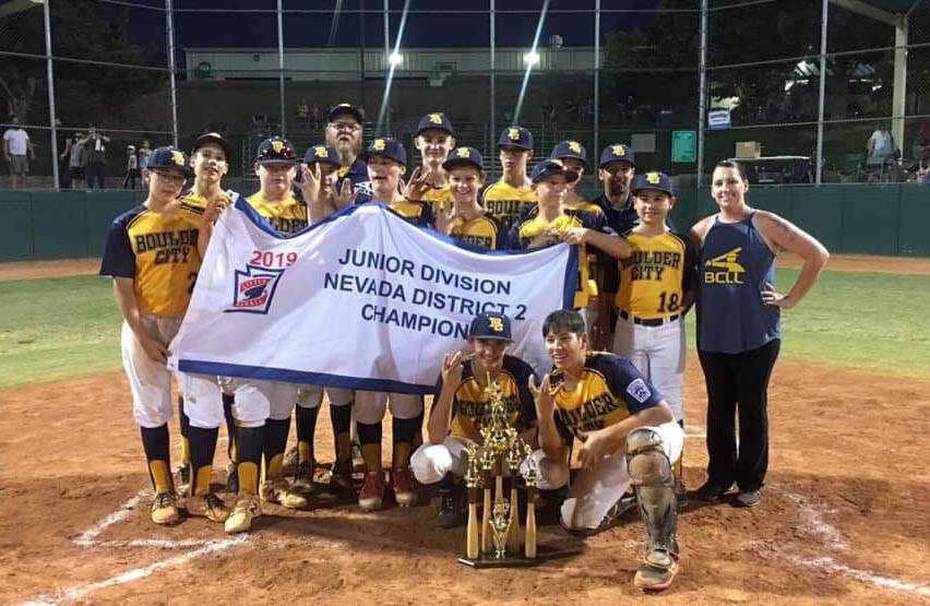 (Katie Kilar) Members of Boulder City's Little League team celebrate winning the District II ...