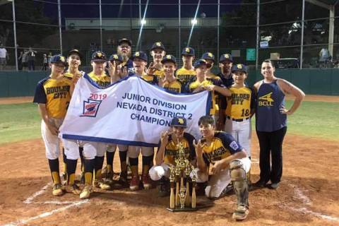 (Katie Kilar) Members of Boulder City's Little League team celebrate winning the District II ...