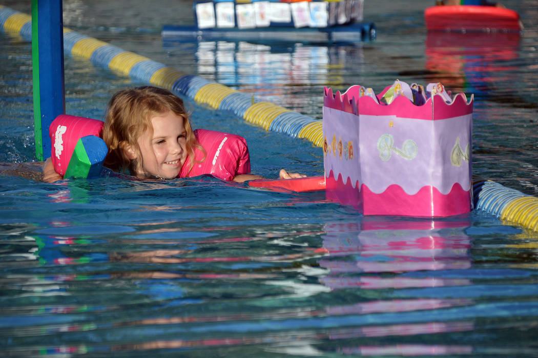 Celia Shortt Goodyear/Boulder City Review Four-year-old Kinsley Irwin races her boat, U.S.S. Ra ...