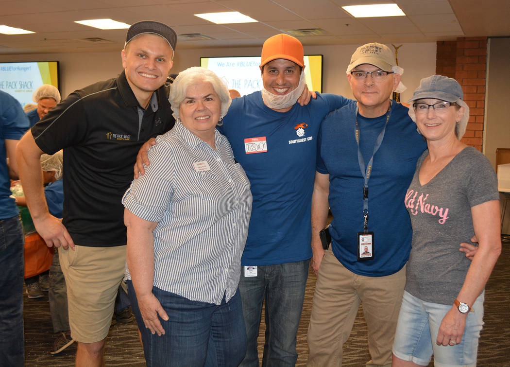 (Southwest Gas) Marita Rhinehart, second from left, from Emergency Aid of Boulder City attended ...