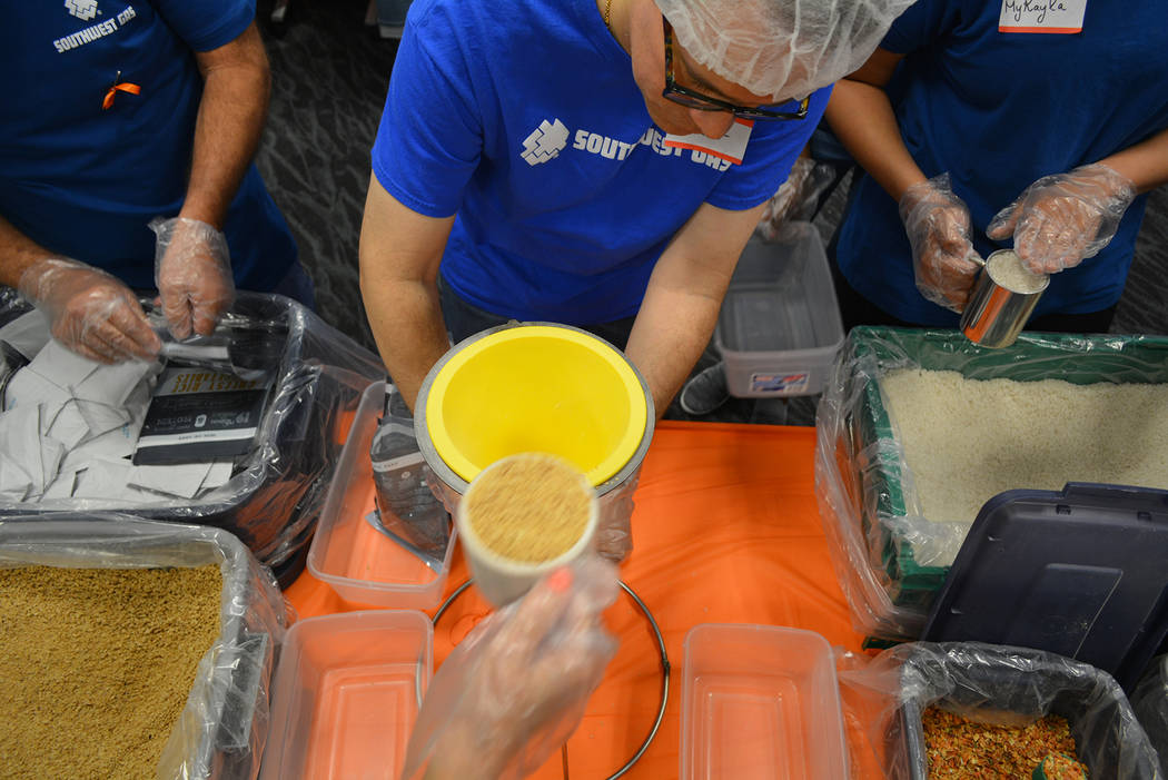 (Southwest Gas) Nearly 140 volunteers attended Southwest Gas' Pack Shack event Saturday, July ...