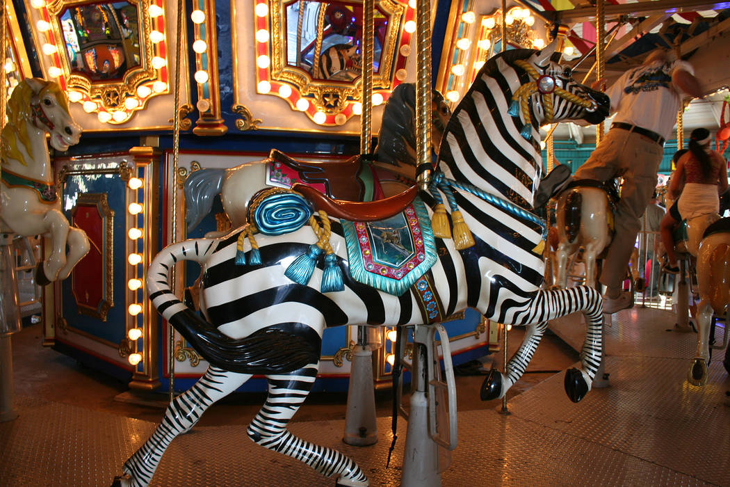 (Deborah Wall) Brightly painted animals, such as this zebra, are a big draw for children who wa ...