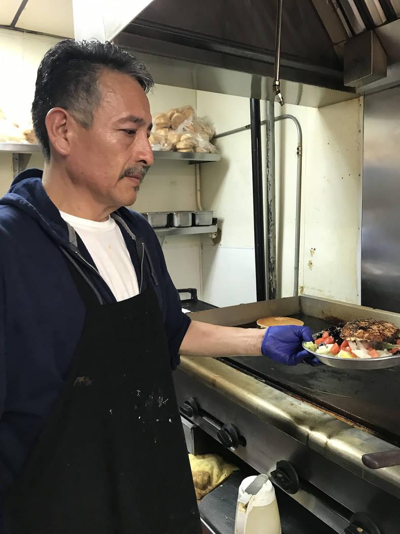 (Hali Bernstein Saylor/Boulder City Review) Jose Bejar, a cook at Southwest Diner, prepares a g ...