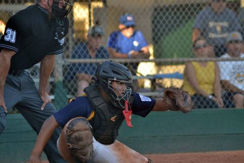 (Boulder City Little League) Catcher Cameron Calvez prepares to catch a pitch for Boulder City ...