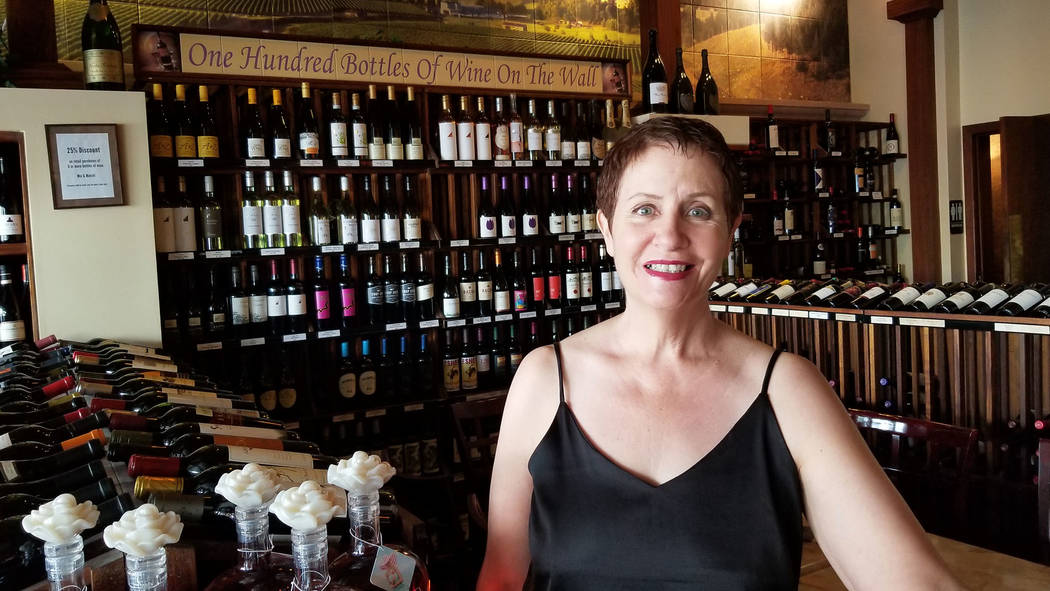 Celia Shortt Goodyear/Boulder City Review Cameron Sisk showcases the 100 bottles of wine availa ...