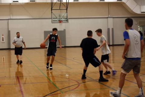 (Kelly Lehr) Nathan Sacco from All Kinds Services brings the ball down the court against Woodbu ...