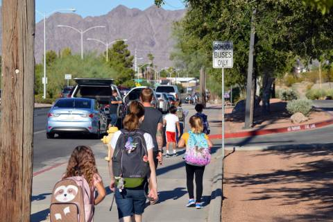 (Celia Shortt Goodyear/Boulder City Review) Students walk to school before class starts Tuesday ...
