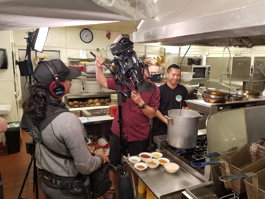 (Terry Stevens) Jay Lavetoria, right, a cook at the World Famous Coffee Cup, is filmed in Octob ...