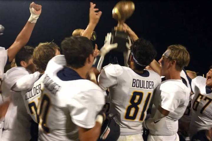 (Amy Wagner) The Boulder City High School varsity football team celebrates its 12-7 road victor ...