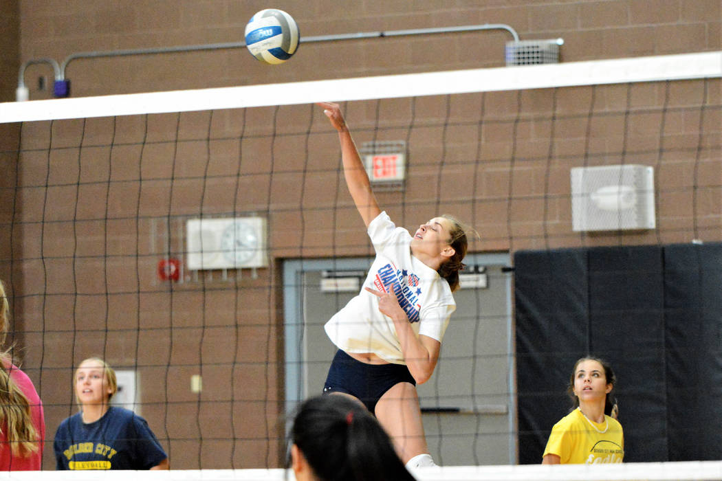 (Robert Vendettoli/Boulder City Review) Rising through the air, junior Kamry Bailey throws down ...