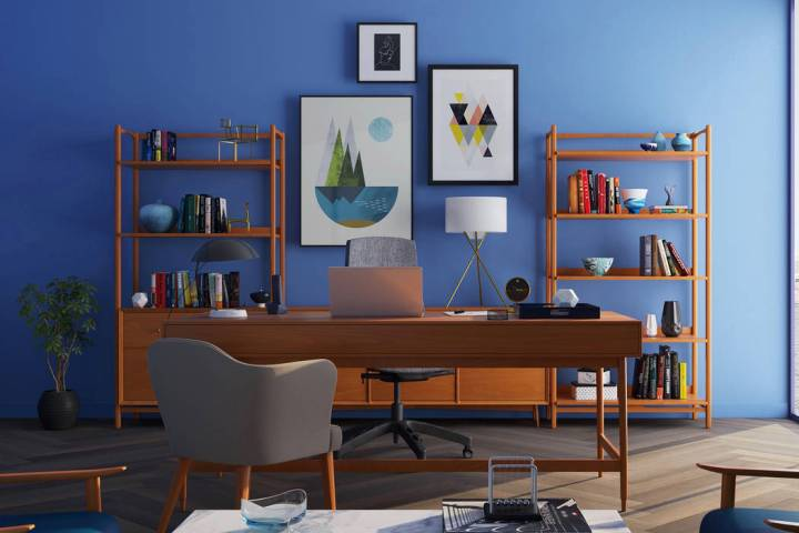 (Norma Vally) A blue accent wall brings color and calm to an office.