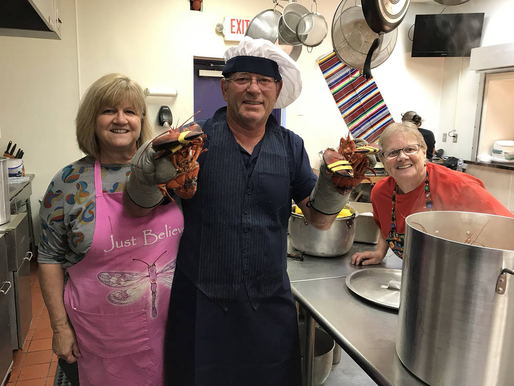 (Hali Bernstein Saylor/Boulder City Review) Maine lobsterman Vance Coulston, center, gets help ...