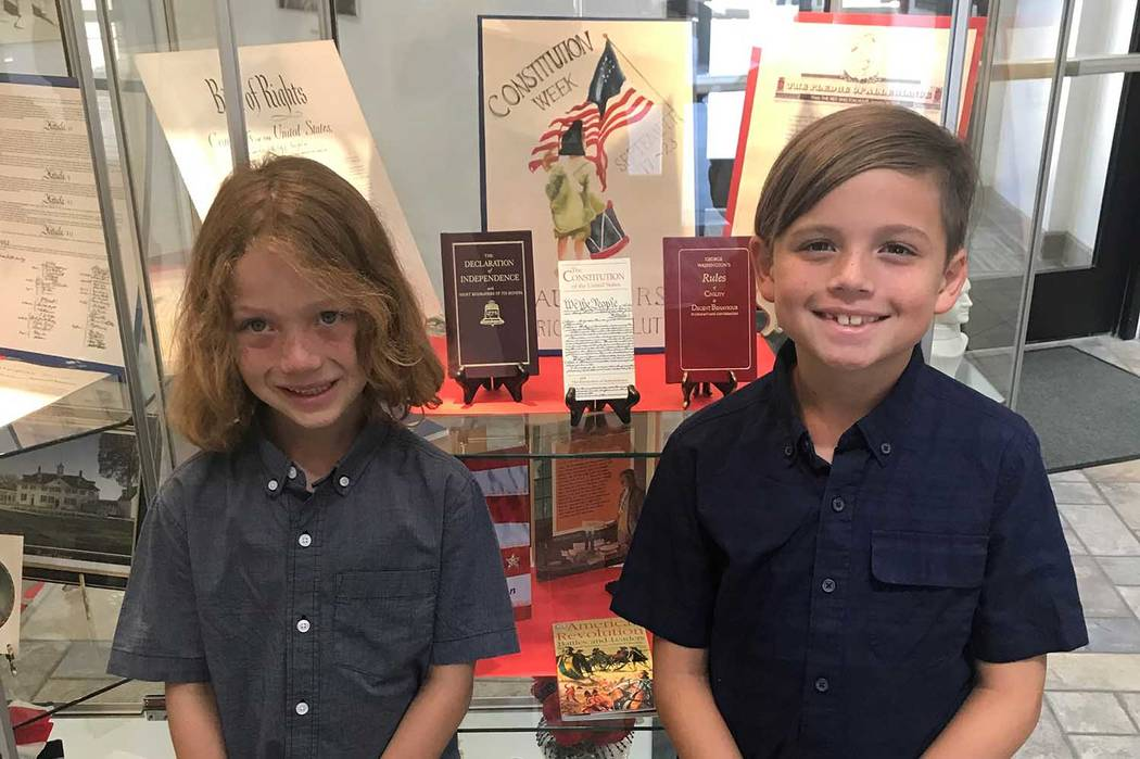 (Susan Mitchell) James Rice and Andrew Rice, great-grandsons of Luanna and Carl Mitchell, stand ...