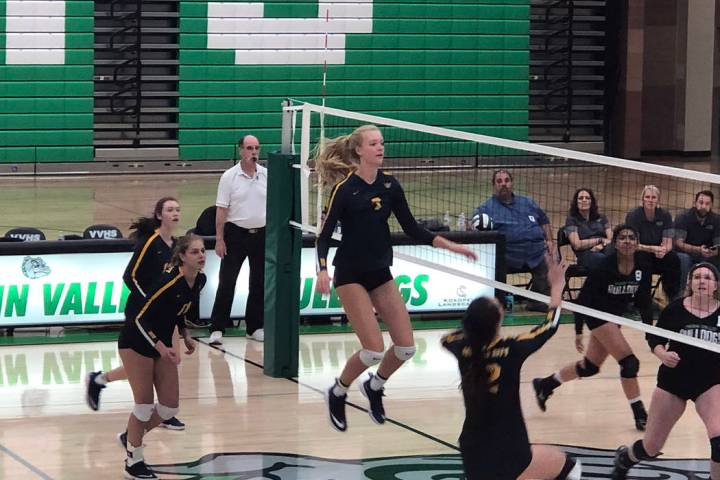 (Boulder City High School) Boulder City High School sophomore Katie Prior jumps for the ball du ...