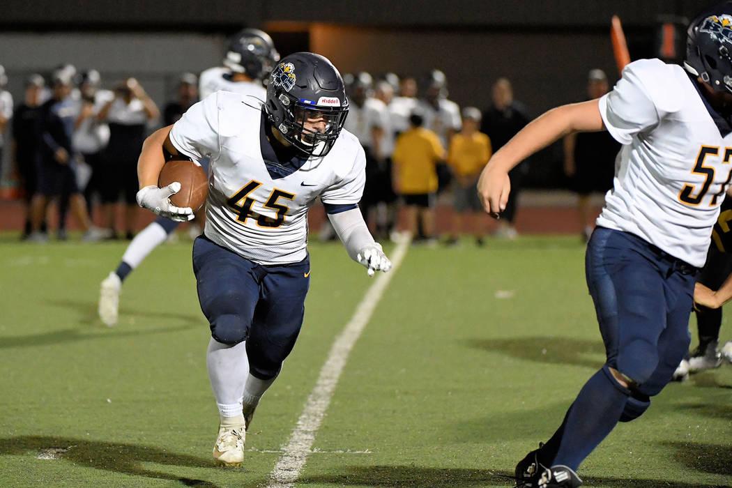 (Peter Davis/Boulder City Review) Boulder City High School senior Devon Walker runs the ball do ...