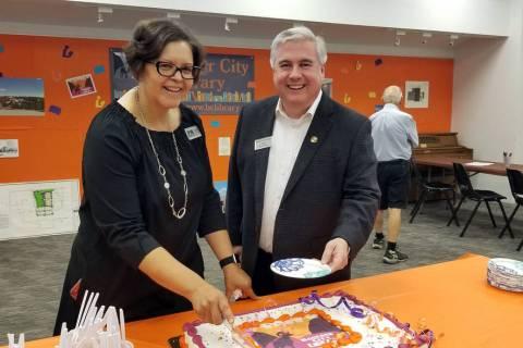 (Celia Shortt Goodyear/Boulder City Review) Boulder City Library Director Kim Diehm cuts the ca ...
