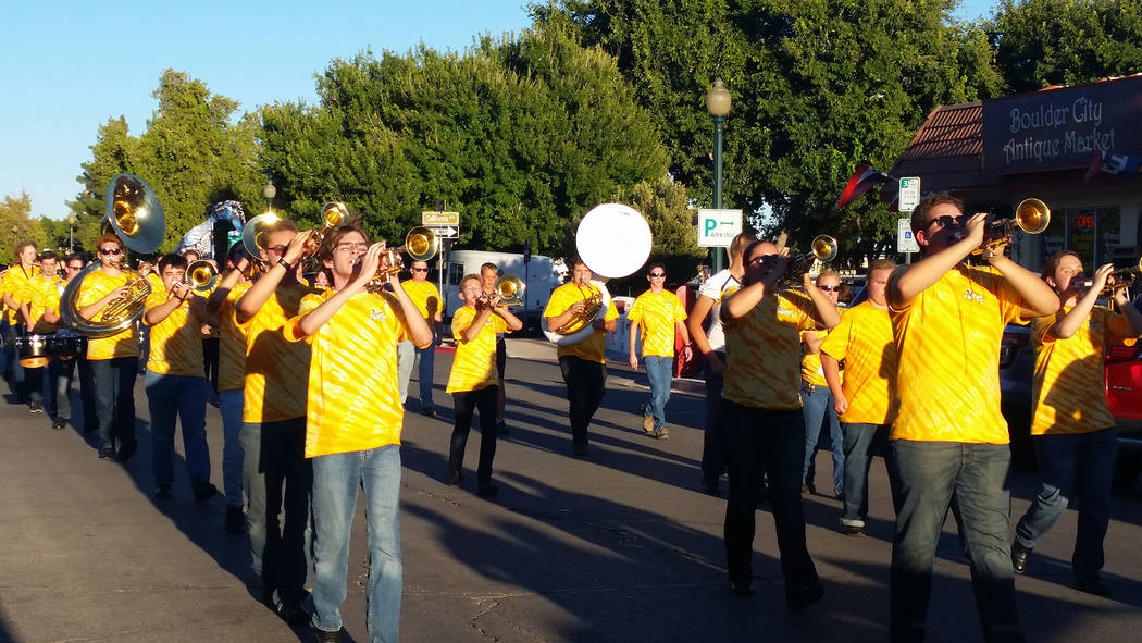 The Boulder City High School marching band starts off the 2018 homecoming parade in downtown Bo ...
