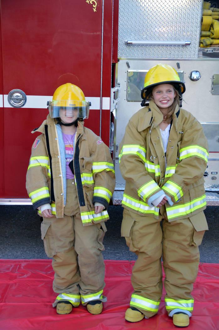 Celia Shortt Goodyear/Boulder City Review Katrina Names, left, and Haley Ferch try on firefight ...