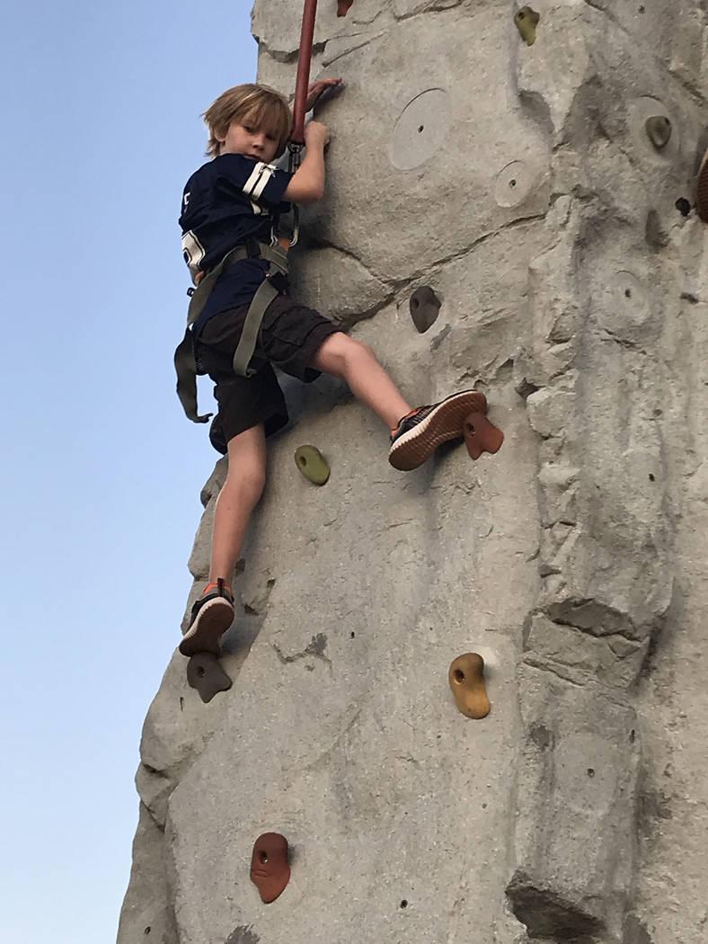 (Hali Bernstein Saylor/Boulder City Review) Gavin Donohue, 8, of Boulder City tries out the roc ...