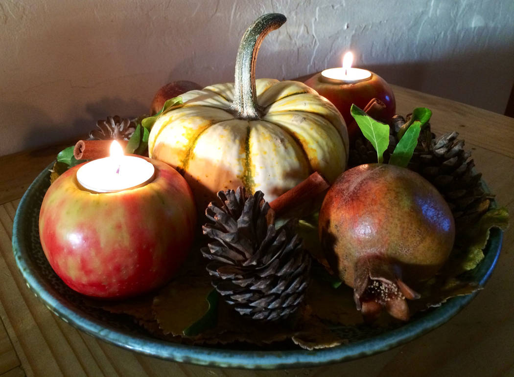 (Norma Vally) Create your own fall-scented candle by carving out space for a tealight in an app ...