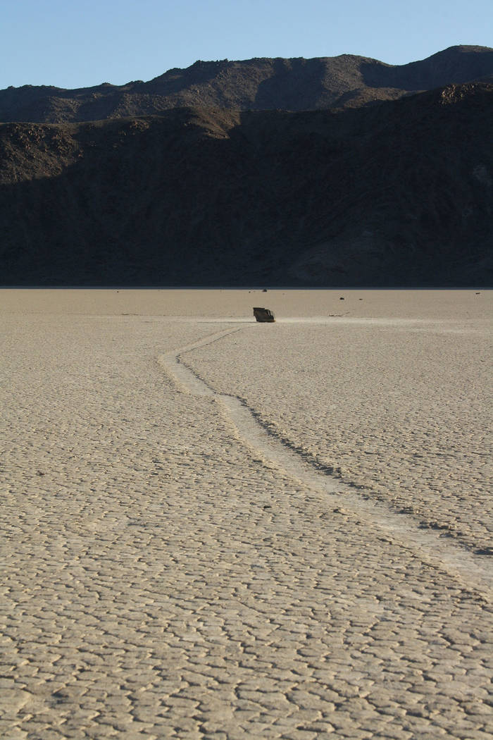 (Deborah Wall) Mysterious roaming boulders leave their own trails on the Racetrack playa in Dea ...