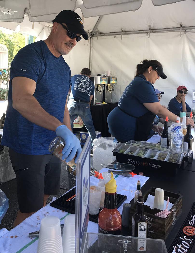 (Hali Bernstein Saylor/Boulder City Review) Tom Maher, CEO of Boulder City Hospital, helps with ...